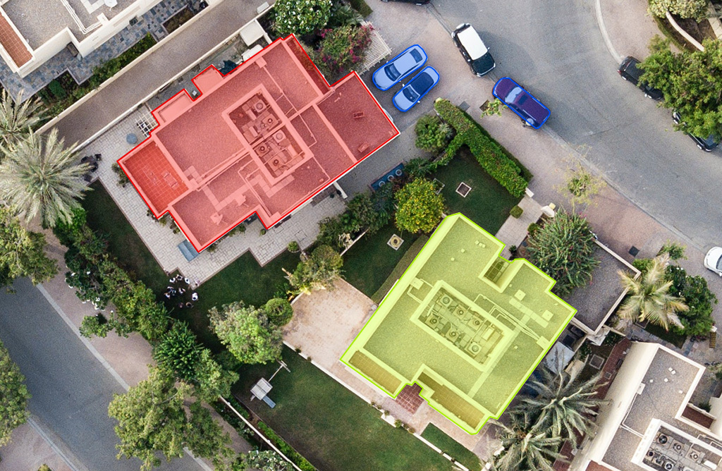 Top view of 2 homes along with 3 cars